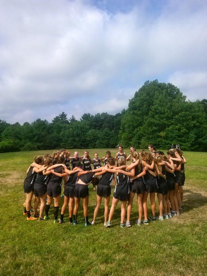 The+girls%27+cross+country+team+gathers+together+before+their+race+at+the+Injury+Fund+meet+on+Sat.%2C+Sept.+6.