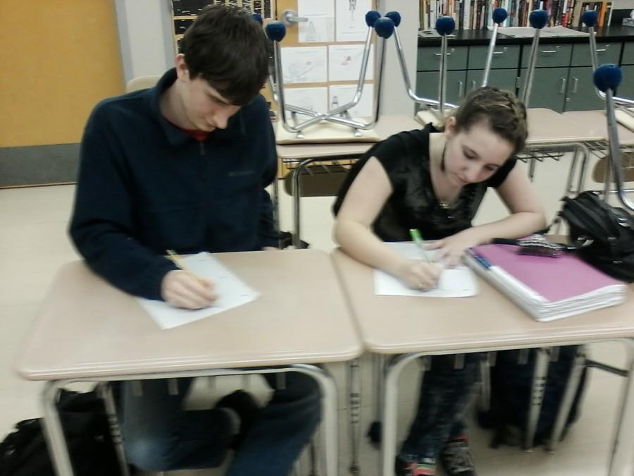 Seniors+Taber+Hersum+and+Maesy+Edmonstone+write+their+own+poems+at+the+Dec.+2+Poetry+Club+meeting.+