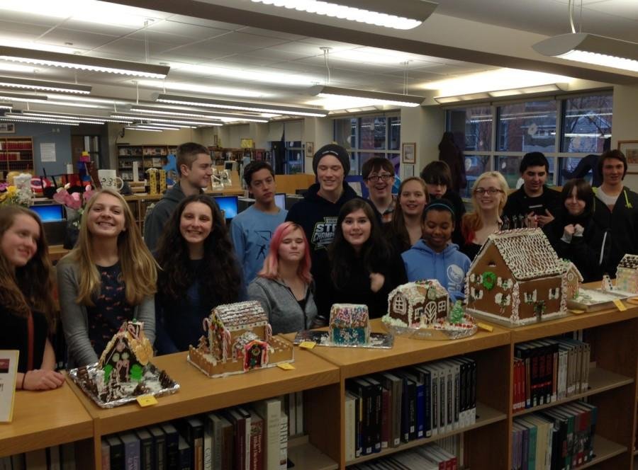 German+students+pose+behind+their+Gingerbread+houses+in+December.+In+addition+to+potential+cuts+in+the+Fine+Arts+Dept.%2C+German+1+is+tentatively+slated+for+removal+next+year.+