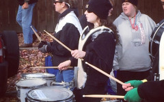Katie Spitalnic plays the drums in the Veterans Day Parade.