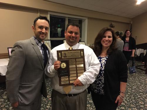 Mr. Adam Laliberte, center, is pictured alongside Mr. Mark DeLucia, left, and Mrs. Paula Schiavone, right. Laliberte recently won the Teacher of the Year Award from the Rhode Island Foreign Language Association.