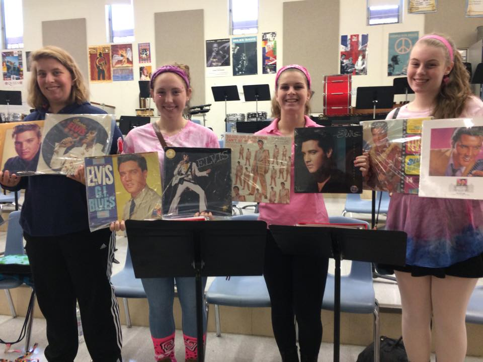 Seniors Haley Kelly, Kara Schultz, Allie O'Connor, and Emily Healey pose with Elvis albums in their History of Pop class, which offers three EEP credits.