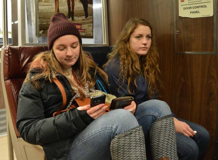 Seniors Sarah Beatty and Katie Connolly ride the Amtrak from Providence.