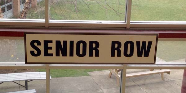 Senior Row sign that hangs over the benches.