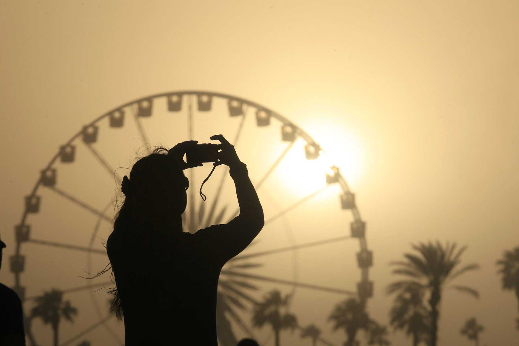 The sun sets on another day of the Coachella Music and Arts Festival on Sunday, April 14, 2013, in Indio, California. (Brian van der Brug/Los Angeles Times/MCT)