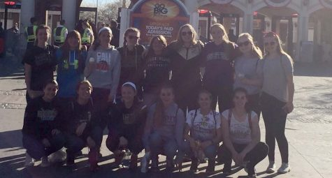 the NK Girls softball team pose outside 6 flags at a team trip they took over break.