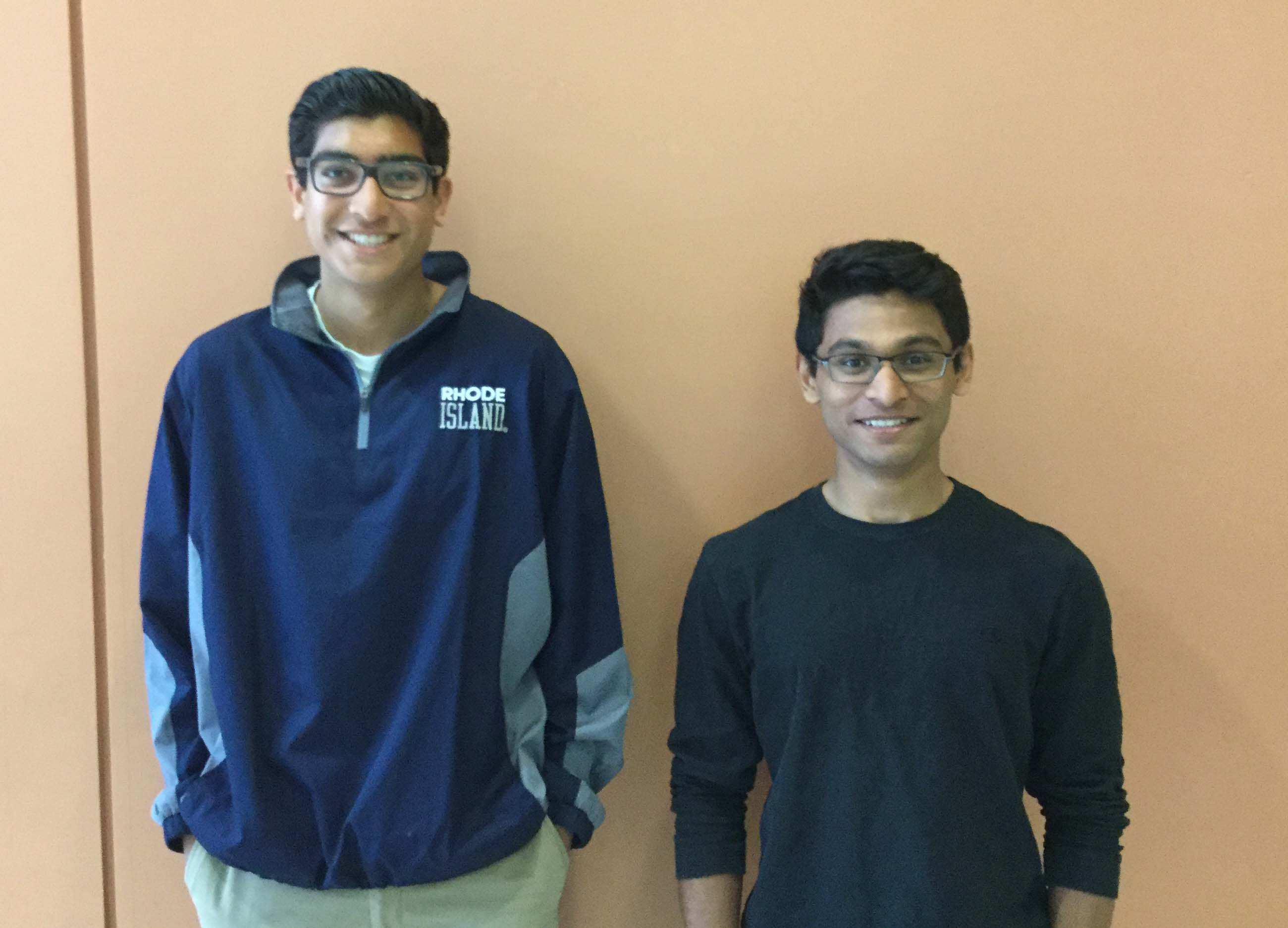 Senior and Junior Patel stand side by side.
