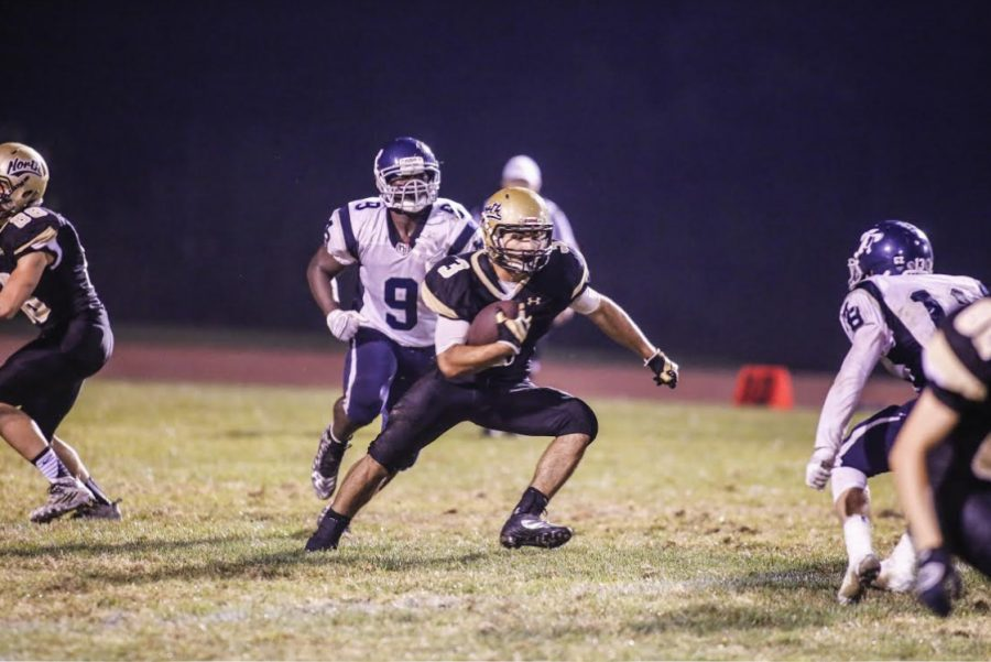Chris George dashes through the hole in the the opposing defense to score a touchdown for NK.