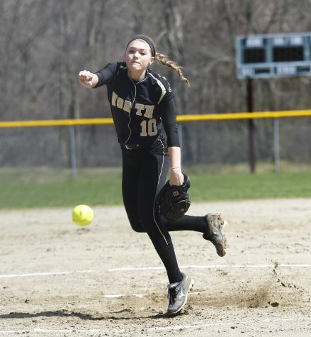 Sabrina Oliver throws a pitch during a game.