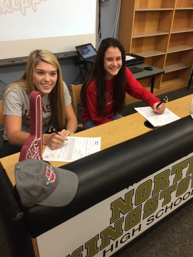 Seniors Kiara Oliver, left, and Meg Maguire, right, sign their National Letters of Intent during a ceremony in November.  Maguire and Oliver are two of the six seniors who will be competing at the Division 1 level next year.