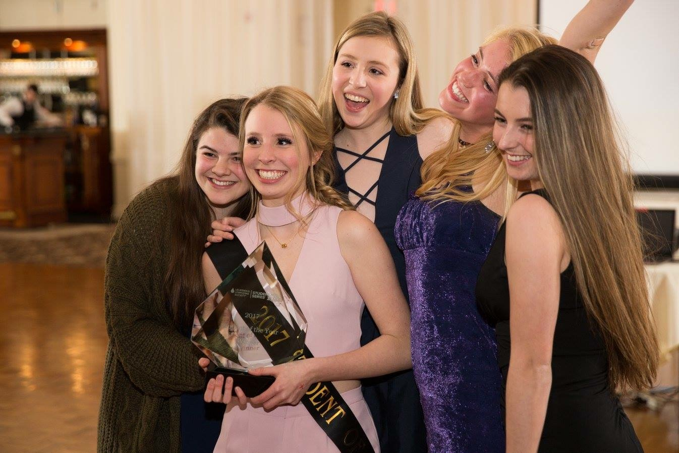 Junior Ali Hornung, center, is pictured with her younger sister, Brooke, and several of her friends at the LLS Awards Dinner on March 4.