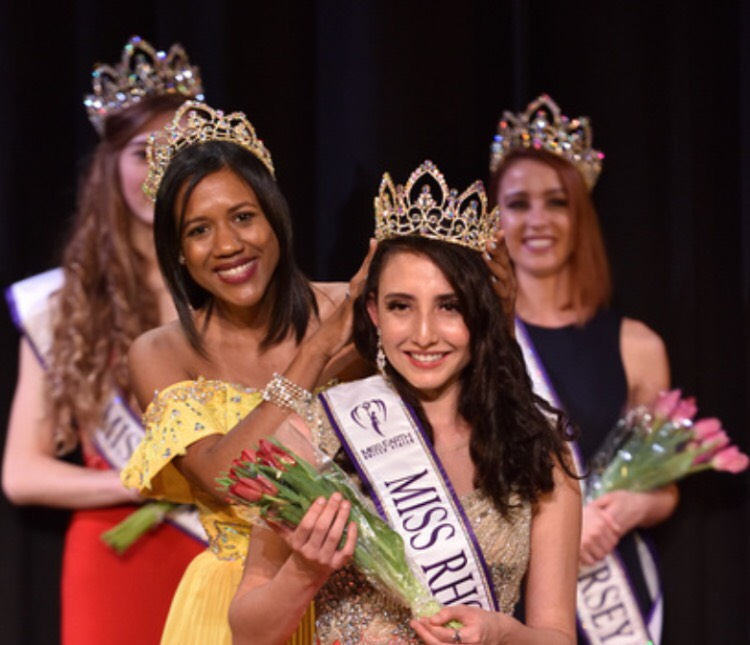 Isabella+Bennett%2C+center%2C+the+2017+Miss+Rhode+Island+Earth+United+States+honoree%2C+receives+her+crown+during+the+Miss+Earth+United+States+Pageant.+