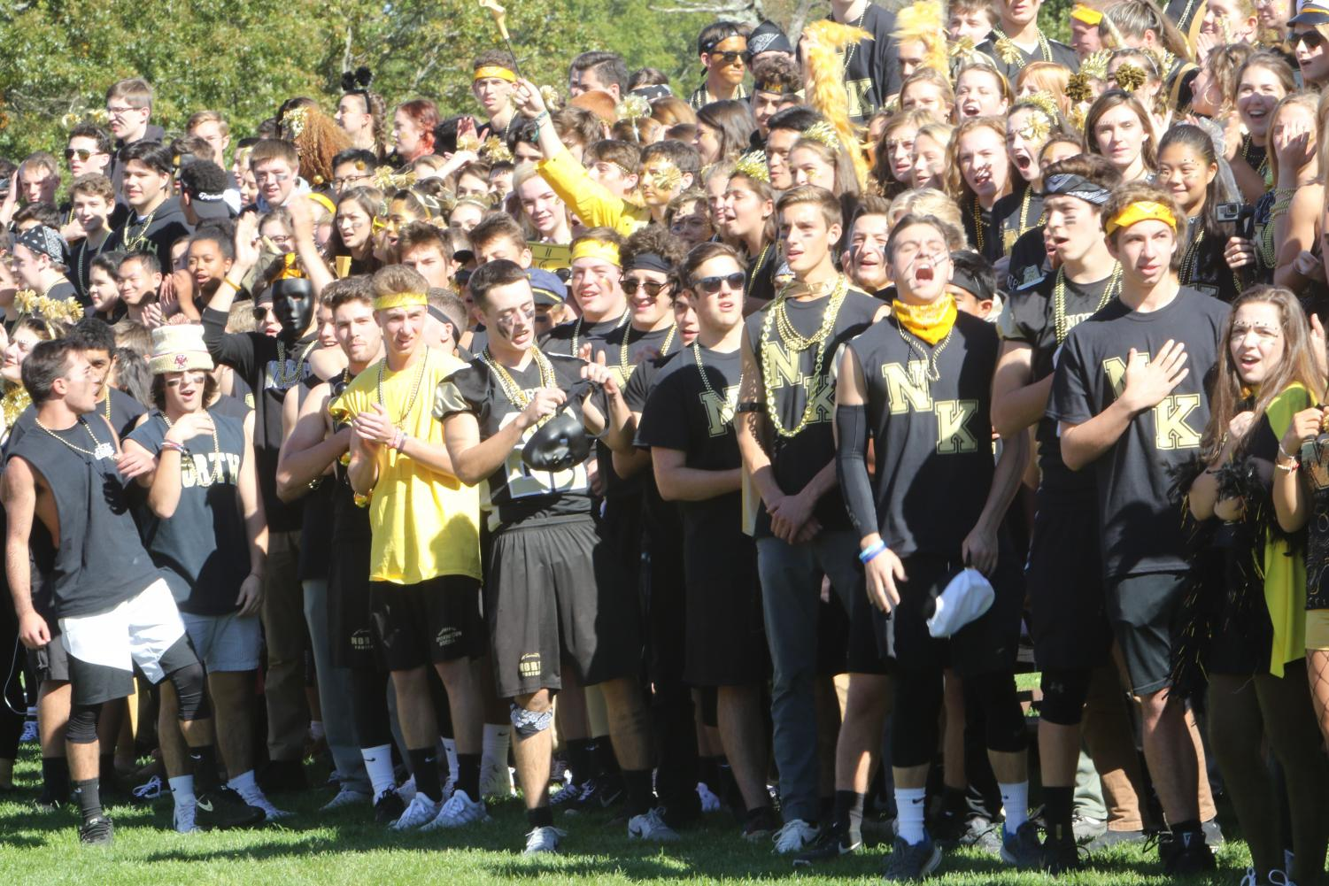 Seniors out on the field wearing black and gold. Picture Credit to Robert Silveria.